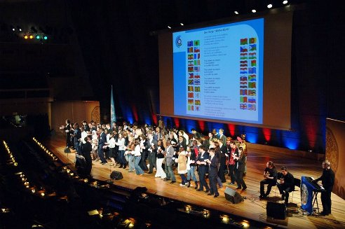 Students from all over the world join in singing the