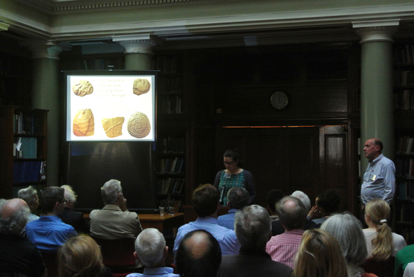 Sarah Day, GSL Earth Science Communicator, introduces Paul Taylor from the Natural History Museum, in the Upper Library