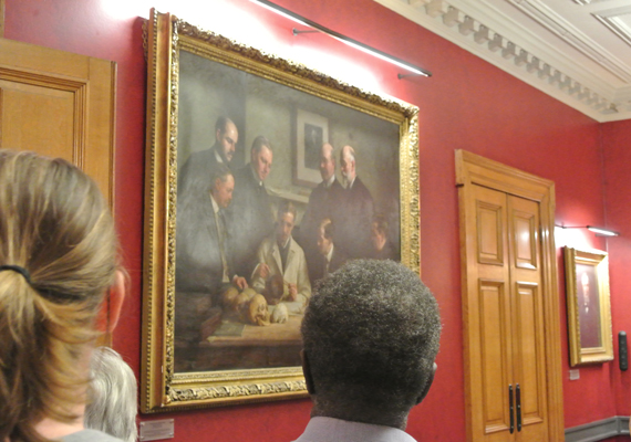Visitors enjoy viewing 'Discussion on the Piltdown Skull' in the Society's Council Room