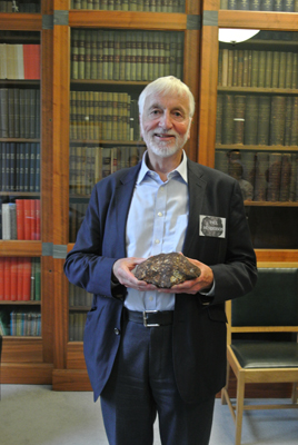 Prof Paul Henderson holds the Society's meteorite